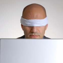 Blindfolded man with laptop